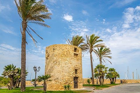 Old defensive military tower near the harbour in Alghero