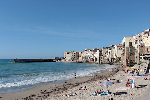 Beach, old town and port in Cefalu