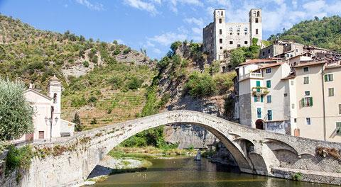 Dolceacqua scenery with castle and old town behind bridge over river