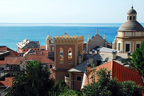 View of historic centre of Finale Ligure and sea beyond