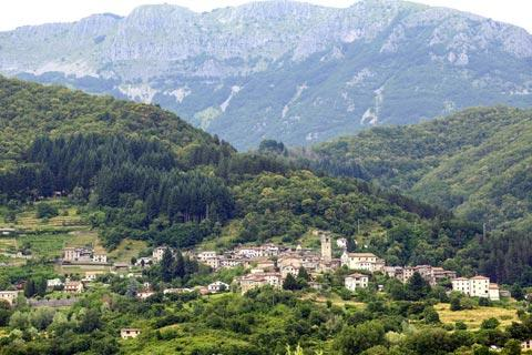 typical Garfagnana village in shadow of mountains