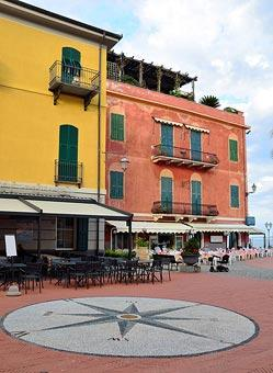 cafes and colourful houses in centre of Laigueglia