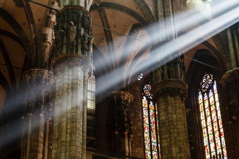 A bright beam of light crosses inside Milan duomo