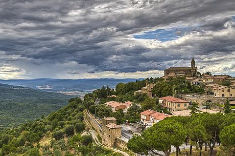 view across rooftops in Montalcino and Tuscany countryside