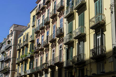 Decorative balconies on colourful houses in centre of Naples