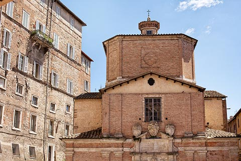 Detail of palazzo and church in historic Perugia