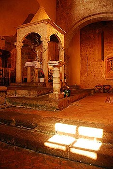 Sunlight on steps inside the Chiesa di Santa Maria in Sovana, Tuscany